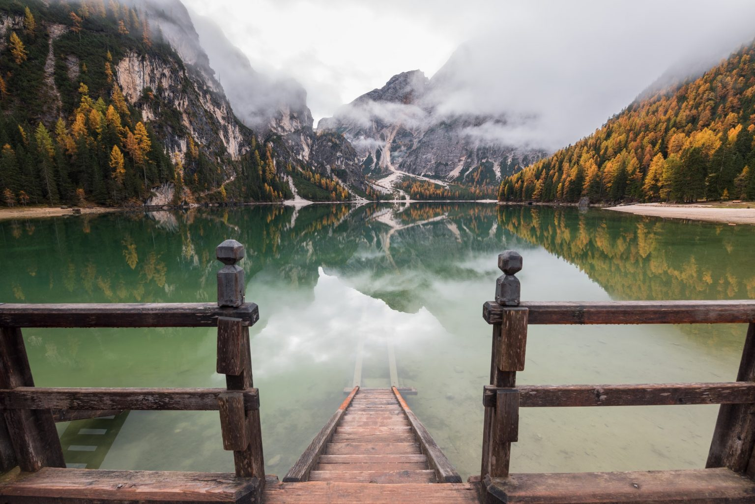 Moody autumn day in the Dolomites forest and mountains